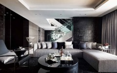 modern-living-space-black-fur-rug-grey-sofa-cushion-black-metal-chair-black-glass-coffe-table-recessed-ceilling-light-staircase-handrail-curtain-black-wall