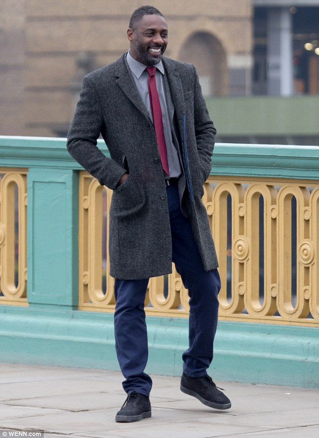 26CD72EA00000578-3002647-He_s_back_Idris_Elba_was_back_in_his_native_London_on_Thursday_w-m-32_1426782961057