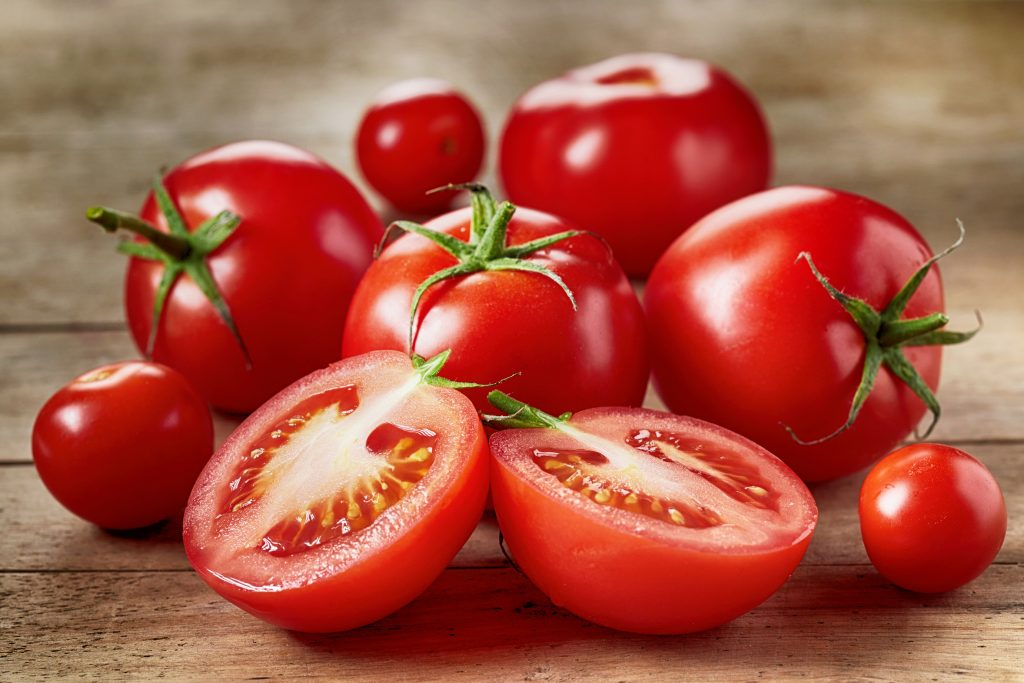 Fresh red tomatoes on wooden table