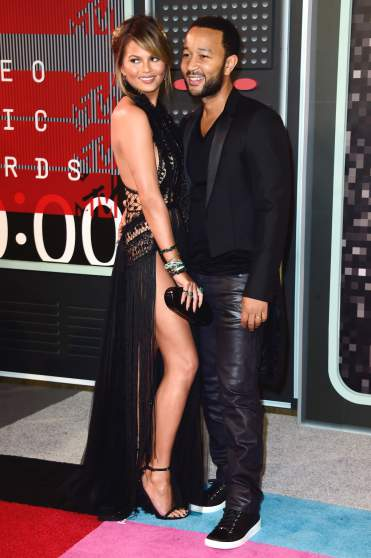 LOS ANGELES, CA - AUGUST 30:  Model Chrissy Teigen (L) and recording artist John Legend attend the 2015 MTV Video Music Awards at Microsoft Theater on August 30, 2015 in Los Angeles, California.  (Photo by Frazer Harrison/Getty Images)