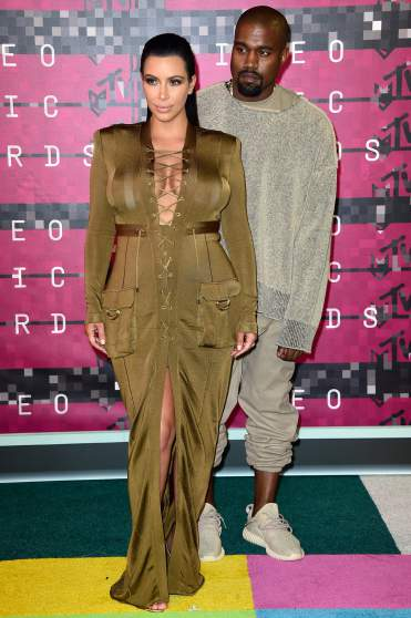 LOS ANGELES, CA - AUGUST 30:  Recording artist Kanye West (R) and tv personality Kim Kardashian attend the 2015 MTV Video Music Awards at Microsoft Theater on August 30, 2015 in Los Angeles, California.  (Photo by Frazer Harrison/Getty Images)