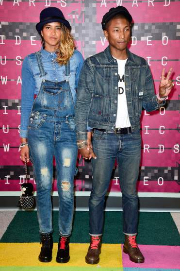 LOS ANGELES, CA - AUGUST 30:  Model Helen Lasichanh (L) and recording artist Pharrell Williams attend the 2015 MTV Video Music Awards at Microsoft Theater on August 30, 2015 in Los Angeles, California.  (Photo by Frazer Harrison/Getty Images)