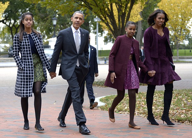 27 Oct 2013, Washington, DC, USA --- United States President Barack Obama walks with his wife Michelle Obama (R) and two daughters Malia Obama (L) and Sasha Obama (2R) across Lafayette Park to St John's Church to attend service in Washington, DC, USA, 27 October 2013. Credit: Shawn Thew / Pool via CNP --- Image by © Shawn Thew/dpa/Corbis