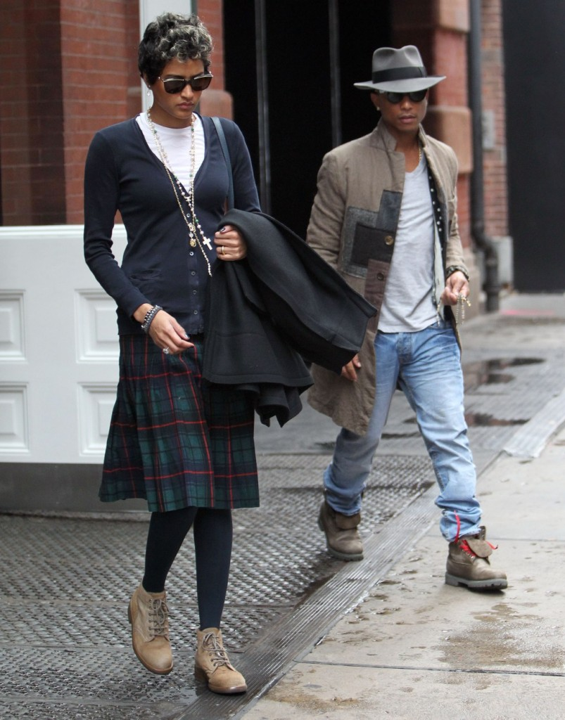 November 01, 2013: Pharrell Williams shows he is a gentleman as he holds the door open for his new wife Helen Lasichanh as they leave their hotel in New York City. Helen wears a tartan kilt similar to what the couple wore on their wedding day. Mandatory Credit: INFphoto.com Ref: infusny-240/141/271|sp|