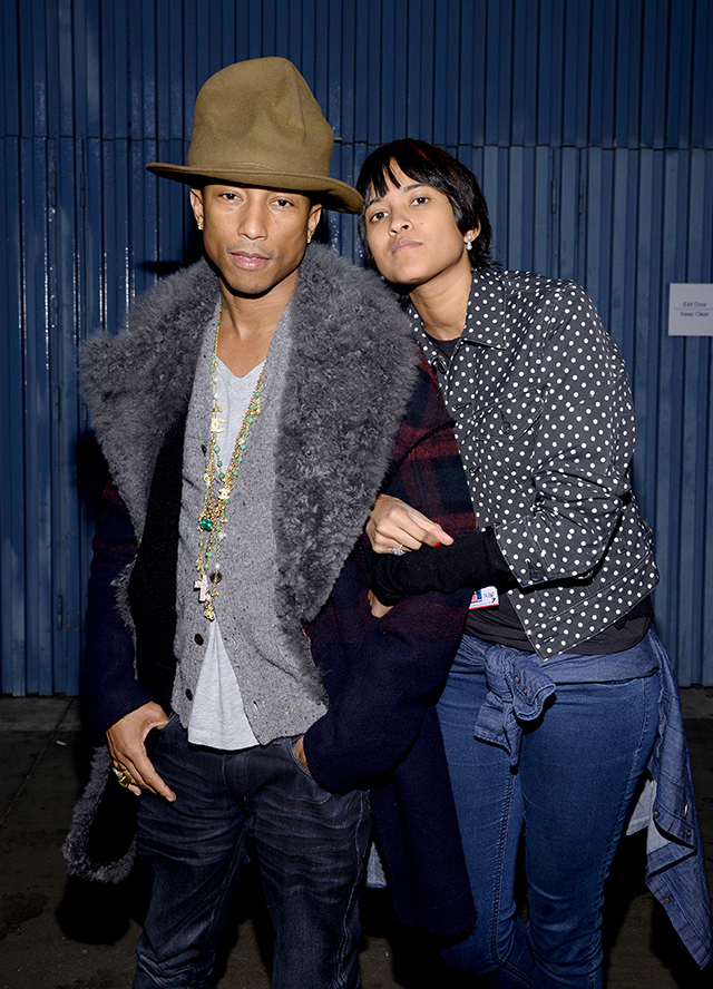 "LOS ANGELES, CA - JANUARY 27: Recording artist Pharrell Williams (L) and Helen Lasichanh attend ""The Night That Changed America: A GRAMMY Salute To The Beatles"" at the Los Angeles Convention Center on January 27, 2014 in Los Angeles, California. (Photo by Larry Busacca/Getty Images for NARAS)"
