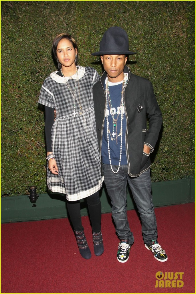 LOS ANGELES, CA - MARCH 29:  Musician Pharrell Williams (R) and model Helen Lasichanh attend MOCA's 35th Anniversary Gala presented by Louis Vuitton at The Geffen Contemporary at MOCA on March 29, 2014 in Los Angeles, California.  (Photo by Jonathan Leibson/Getty Images for MOCA)