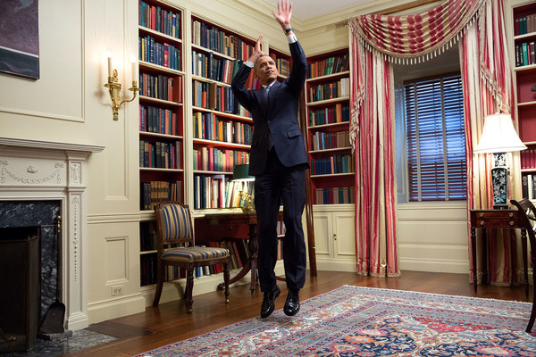 President Barack Obama feigns a jump shot during an Affordable Care Act video taping for BuzzFeed in the White House Library, Feb. 10, 2015. (Official White House Photo by Amanda Lucidon) This official White House photograph is being made available only for publication by news organizations and/or for personal use printing by the subject(s) of the photograph. The photograph may not be manipulated in any way and may not be used in commercial or political materials, advertisements, emails, products, promotions that in any way suggests approval or endorsement of the President, the First Family, or the White House.