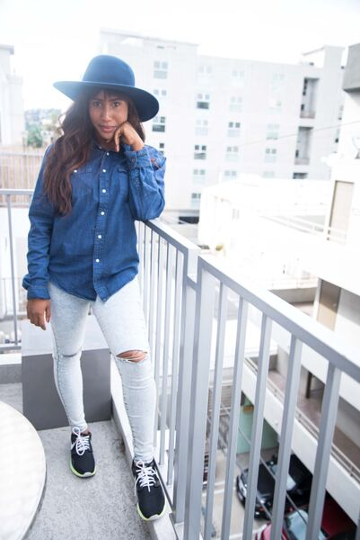 EMERALD SLAYING WITH THE DENIM SHIRT, TATTERED TROUSER, SNEAKERS AND HAT
