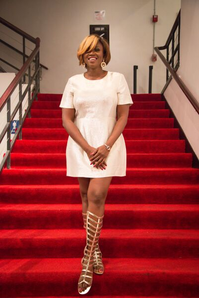 waje ready to step out to the after party with this white metallic dress by warehouse and gold strapped sandals