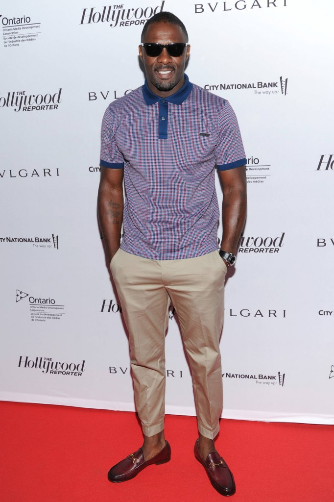 Idris Elba arrives at The Hollywood Reporter's 2013 TIFF Cocktail Reception presented by Bulgari on Sunday, September 8, 2013 in Toronto. (Photo by Evan Agostini/Invision for THR/AP Images)