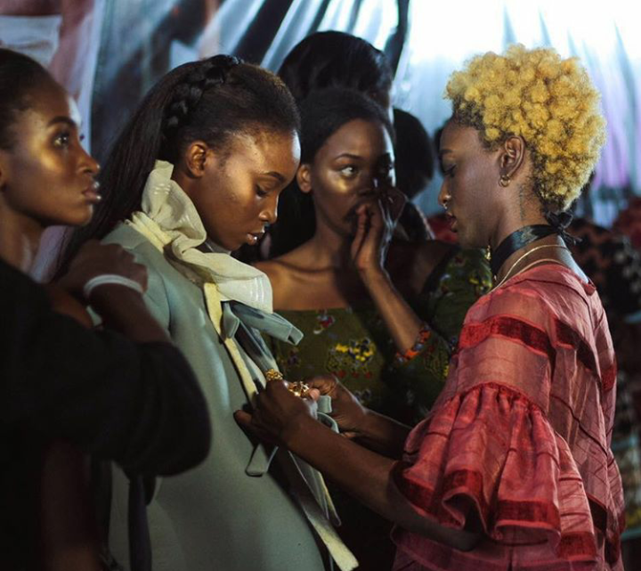 Designer Loza Maleombho touching up model's face just before runway outing