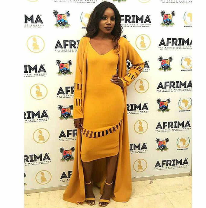Seyi Shay channels monochrome power in this mustard yellow head to toe look...
