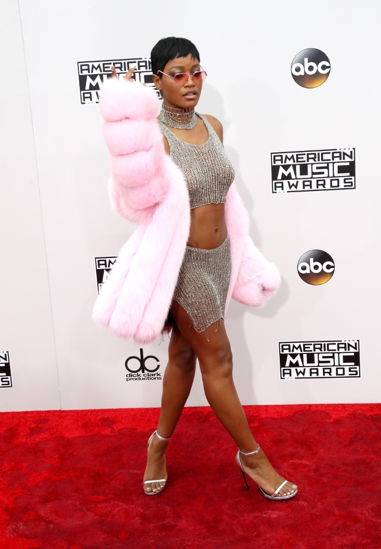 Keke Palmer wears this shimmery Natalia Fedner two piece and pairs with a pink fur coat. Her signature pixie cut always wins...
